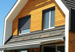 Eco home with external shutters and solar panels