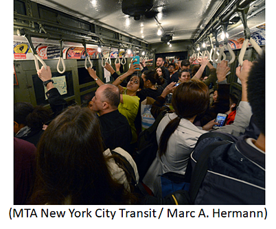 Crowd of commuters on New York subway.