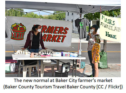 People wearing facemasks at Baker City farmer's market during COVID-19 pandemic