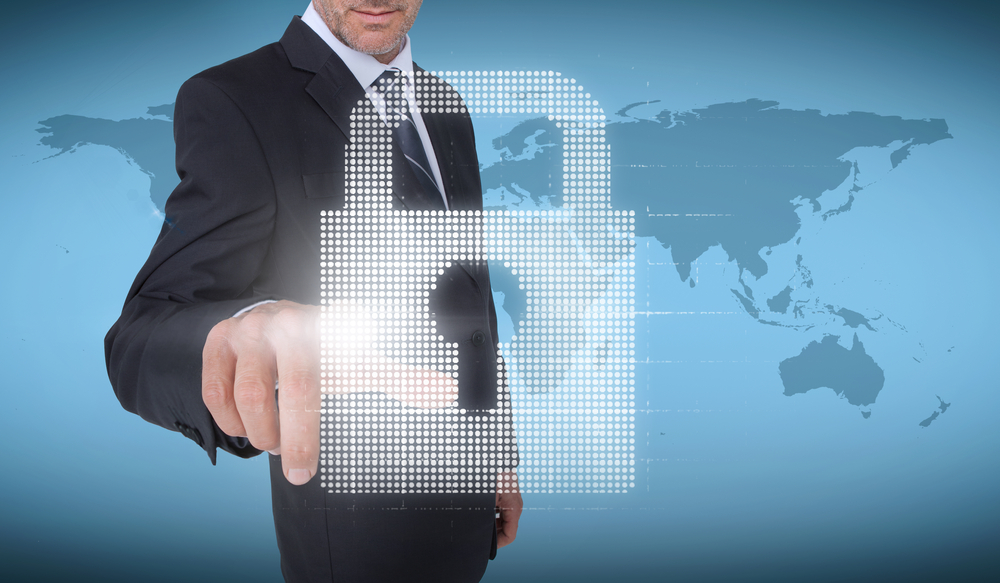 Businessman selecting a padlock with world map on the background