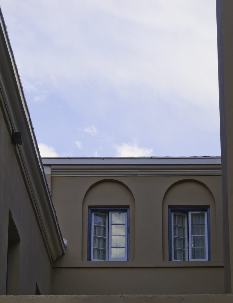 Two sets of blue-framed double windows in late afternoon-2